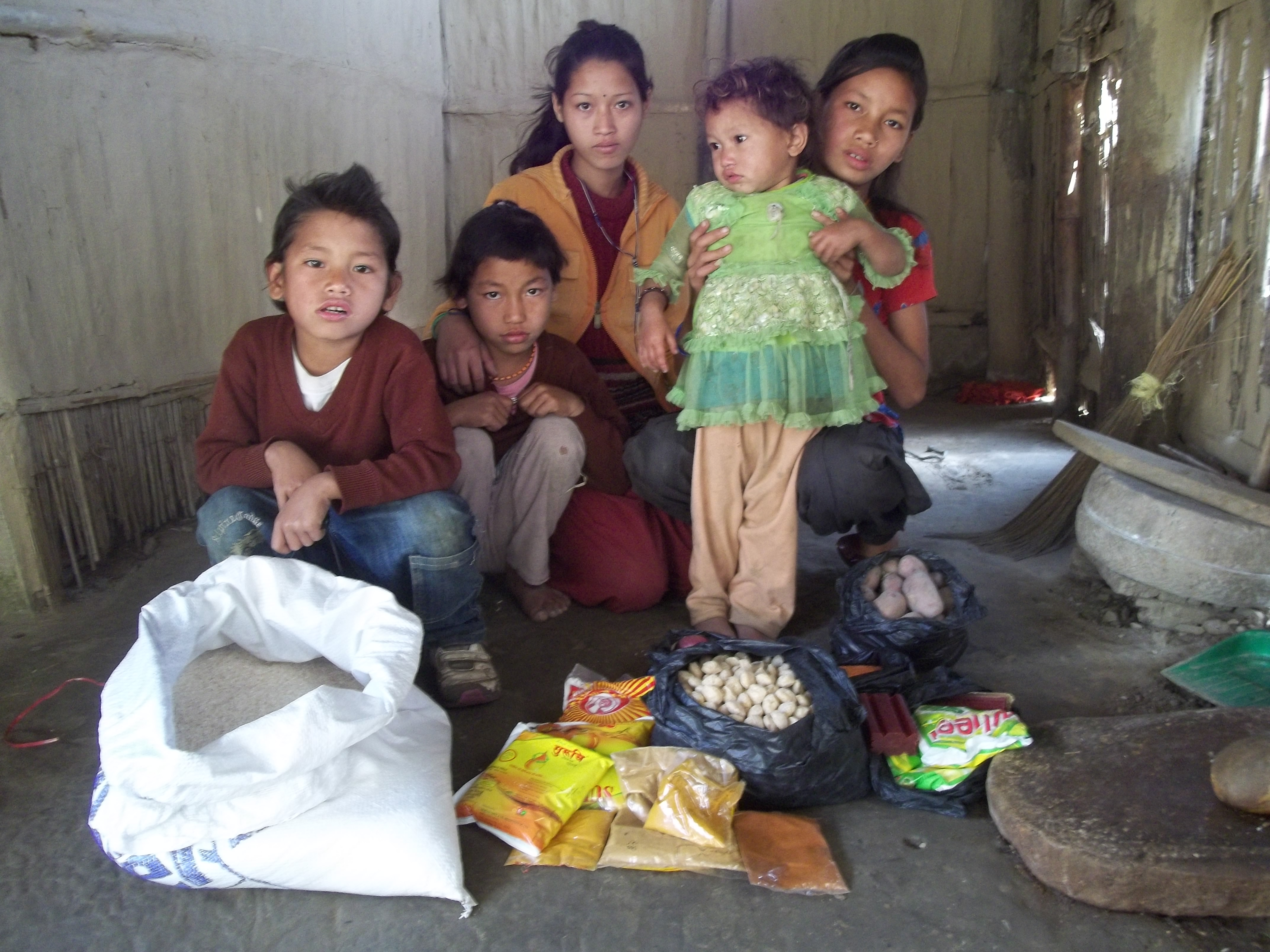 2012-03-05 five orphans receiving food.JPG
